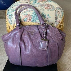 Authentic PRADA distressed purple handbag